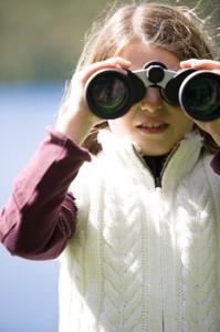 Girl and binoculars
