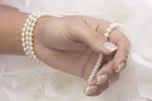 Pearls in her hands